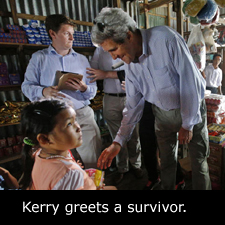 Kerry greets a survivor.